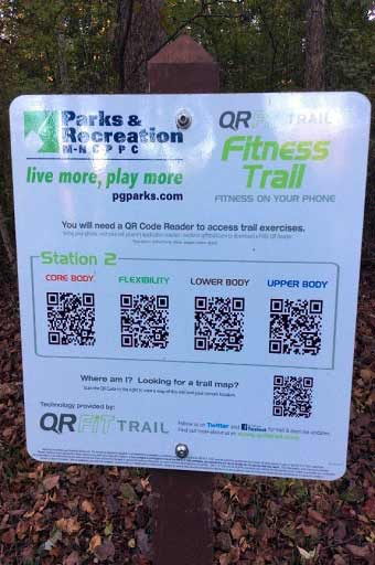 A close up of QR FIT signage on trail