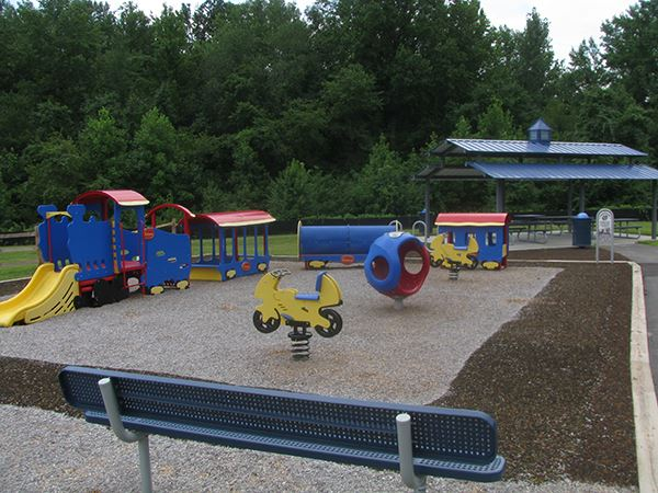 The playground at Horsepen park with blue, yellow, and red play structures.